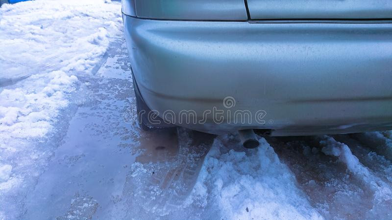 Bad road conditions. The wheel of the car on the road in the thawing snow royalty free stock photography