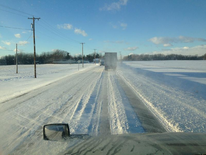 Bad road Conditions. Snow covered road conditions in Winter royalty free stock photography