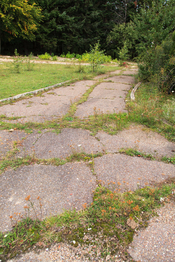 Bad road. A old bad road with cranny in pavement asphalt stock photo