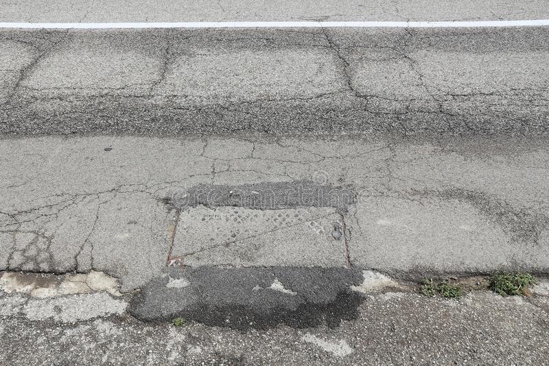 Bad road. Road surface damage - bad maintenance quality. Asphalt cracks in Italy stock images