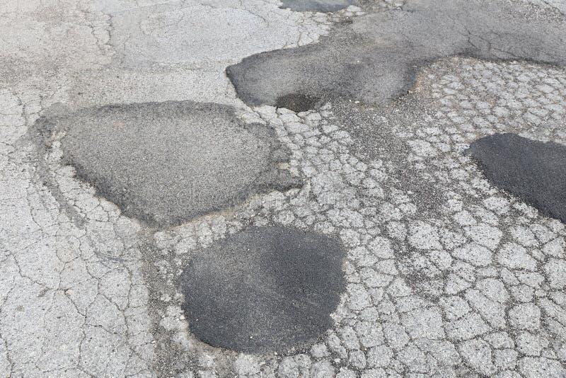 Bad road surface. Road surface damage - bad maintenance quality. Asphalt cracks in Italy royalty free stock images