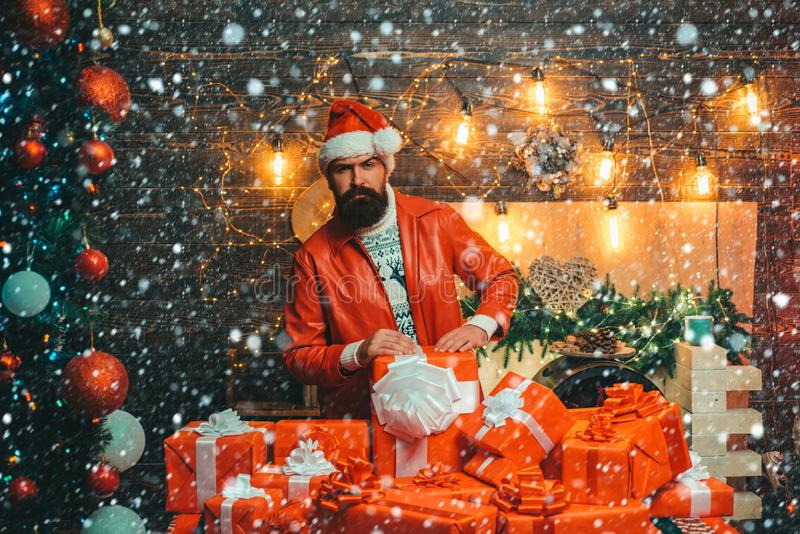 Bad santa claus in santa hat. Bearded man in Christmas sweater. New year concept. Christmas man in santa hat. royalty free stock photo