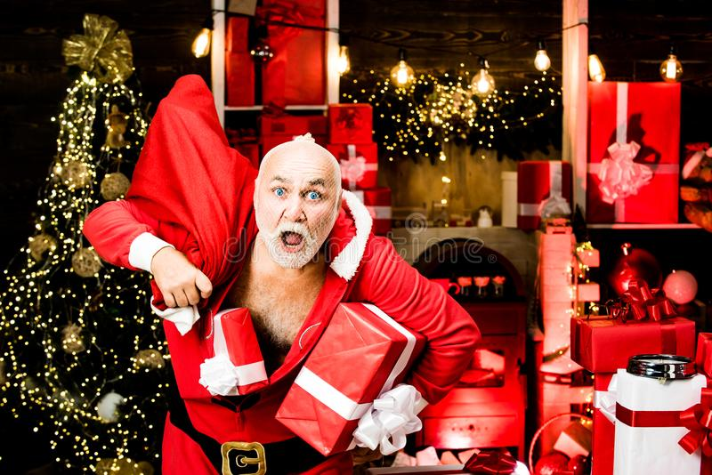 Bad Santas with bags - burglar or thief concept. Holidays filled with fun. Santa with gifts. Best prices for winter stock photography