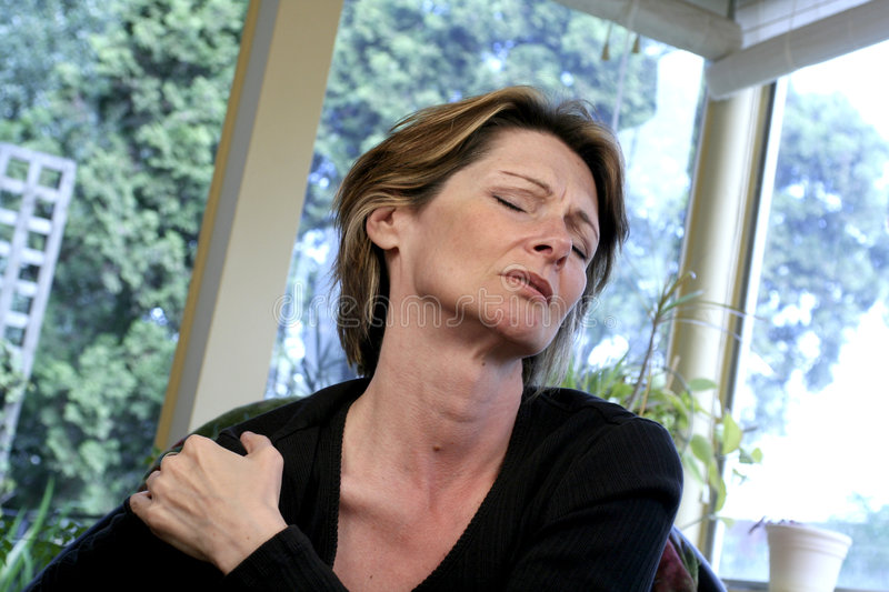 Bad shoulder. Woman with shoulder pain stock photo