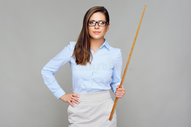 Bad teacher. Woman holding wooden pointer. Isolated portrait stock images