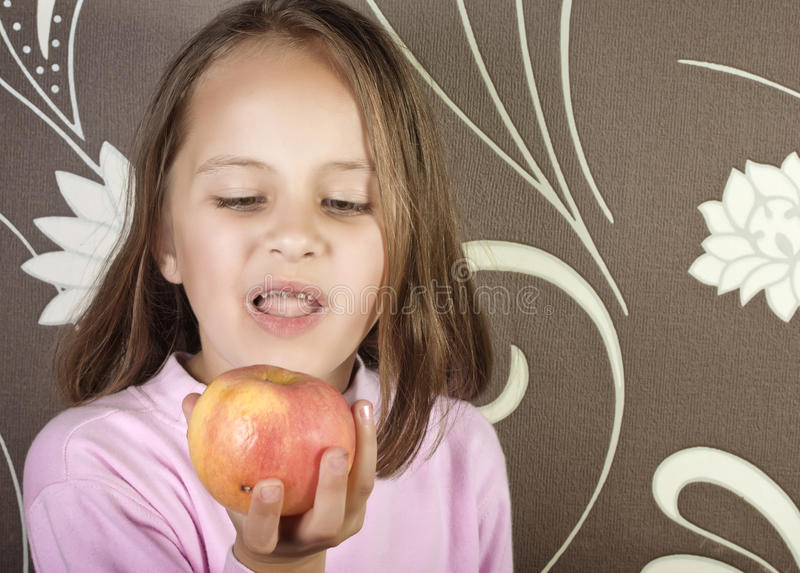 Bad teeth,. Girl with bad teeth and apple royalty free stock images