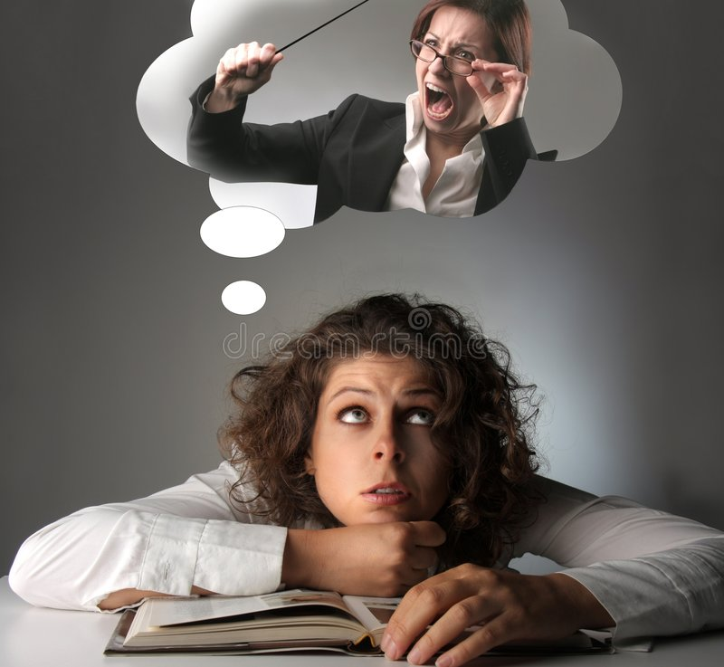 Bad thought. Student thinks to her bad teacher royalty free stock photo
