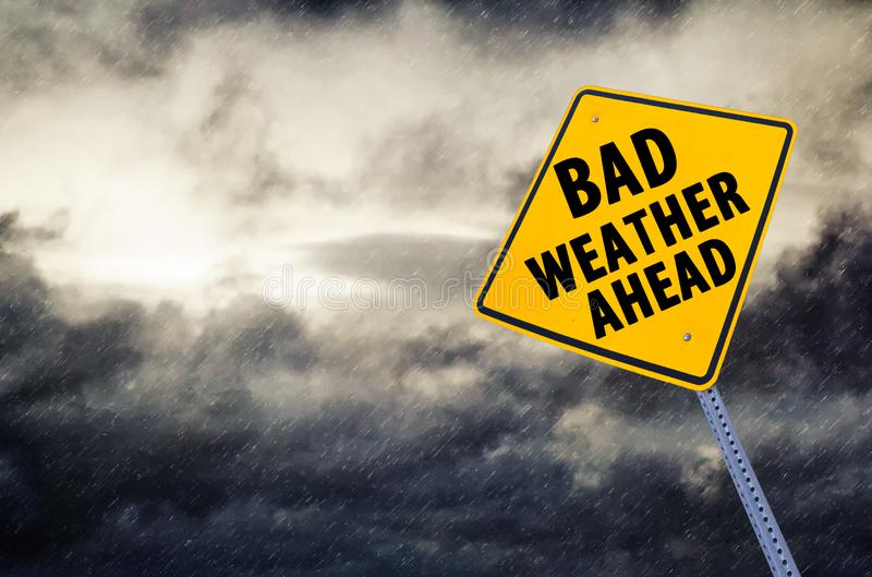 Bad weather ahead  Road Sign. With a stormy weather clouds and rain royalty free stock image