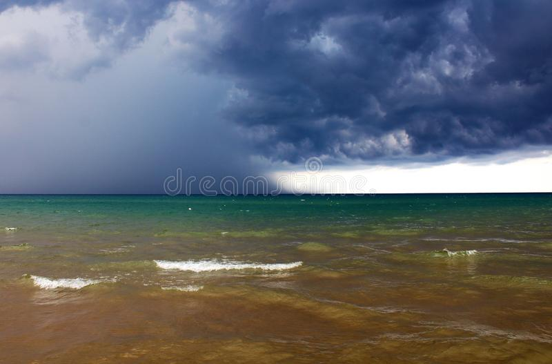 Bad weather with rough seas. And clouds in the background in the Sicilian sea royalty free stock photo