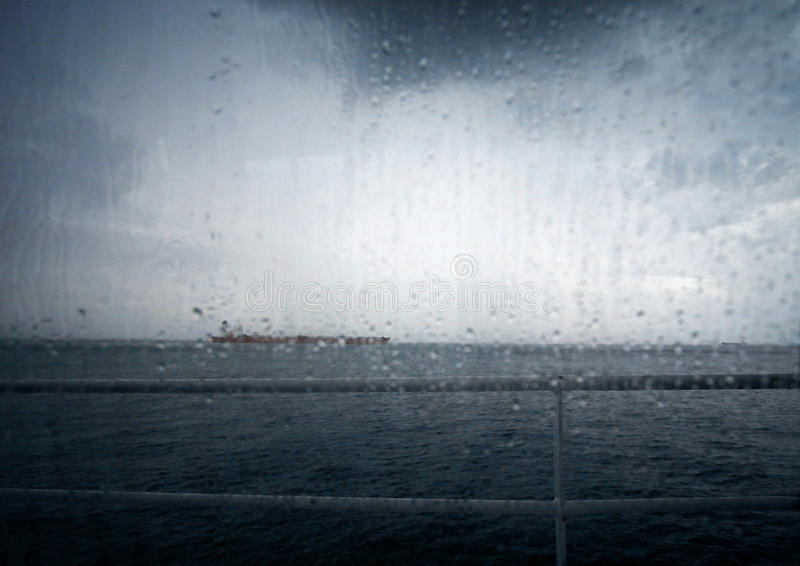 Bad weather at sea. A image taken from the window of a ferry boat out at sea during stormy rainy weather. Conceptual photo for running into inclement weather royalty free stock photography