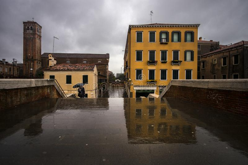 Bad weather in Venice. The bridge has three arches. Italy stock photography