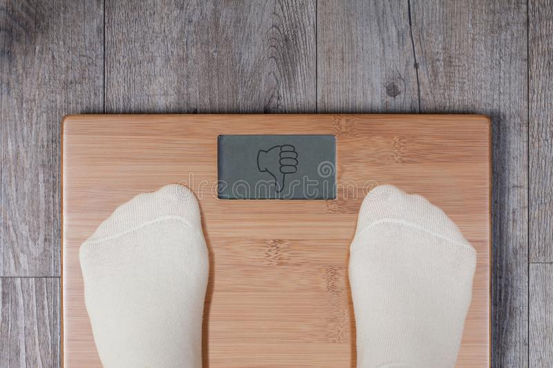 Bad weight - thumb down gesture royalty free stock photos