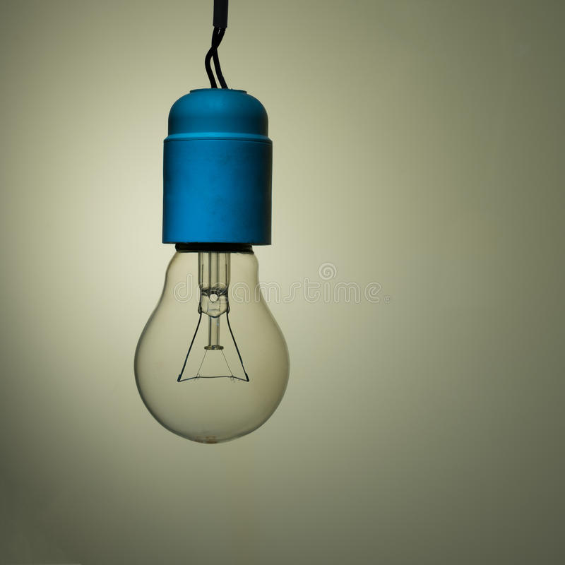 Bad wiring - old incandescent light bulb. Bedsit style - retro incandescent lighting stock photography