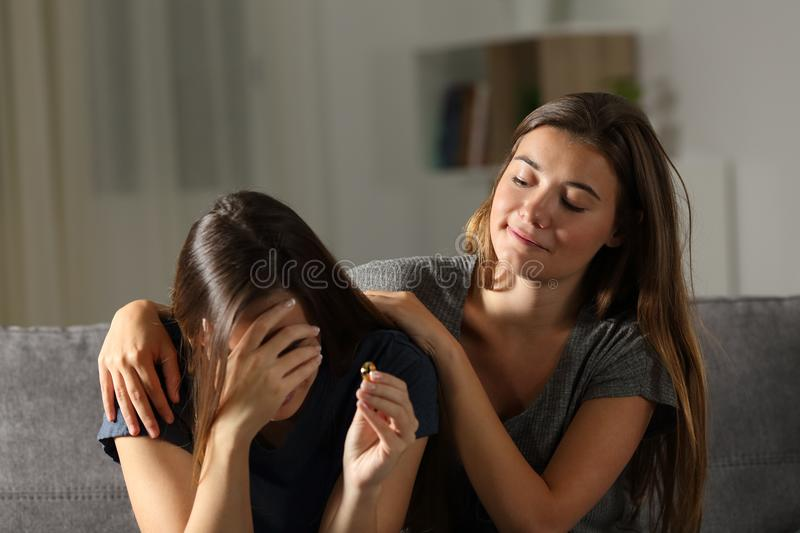 Bad woman is glad about the breakup of a friend royalty free stock photography