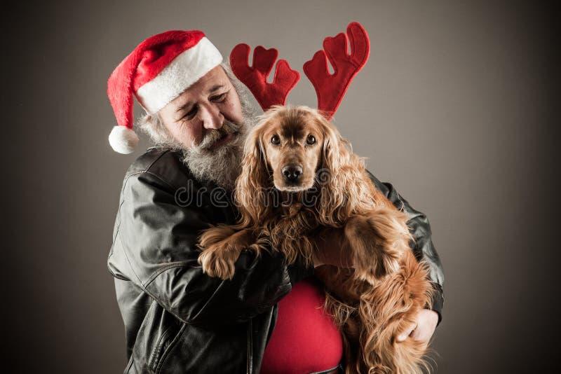 Badass Santa with dog royalty free stock photos