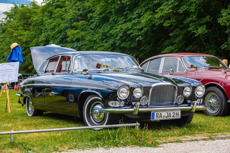 BADEN BADEN, GERMANY - JULY 2019: black JAGUAR MARK X 420G 1961 1970 sedan limousine, oldtimer meeting in Kurpark stock photography