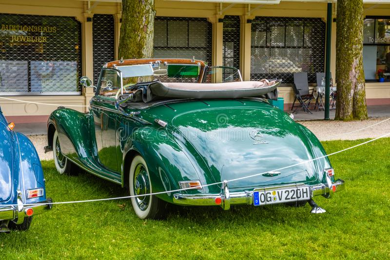 BADEN BADEN, GERMANY - JULY 2019: green MERCEDES-BENZ 220 cabriolet A cabrio roadster W187 1951 1955, oldtimer meeting in Kurpark royalty free stock photos