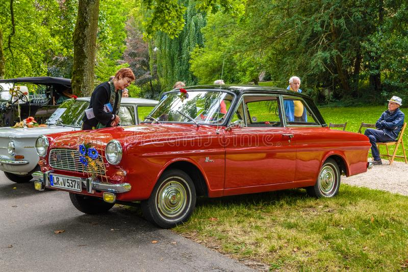 BADEN BADEN, GERMANY - JULY 2019: red FORD TAUNUS CARDINAL P4 12M cabrio 1962 1966, oldtimer meeting in Kurpark stock photo