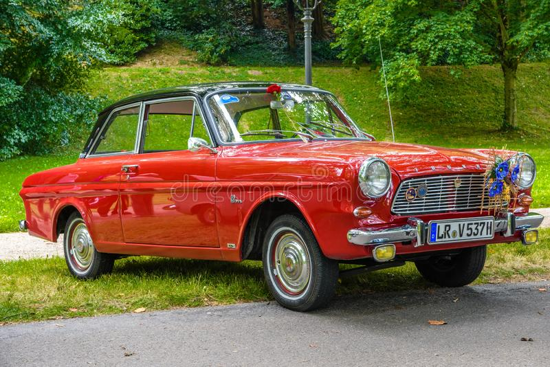 BADEN BADEN, GERMANY - JULY 2019: red FORD TAUNUS CARDINAL P4 12M cabrio 1962 1966, oldtimer meeting in Kurpark royalty free stock photography