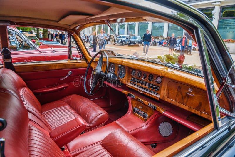 BADEN BADEN, GERMANY - JULY 2019: red leather wooden interior of JAGUAR MARK X 420G 1961 1970 sedan limousine, oldtimer meeting in royalty free stock images