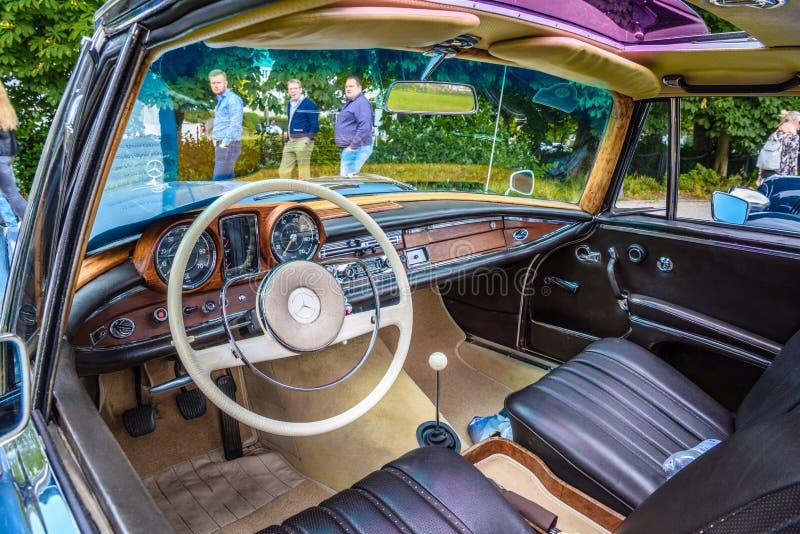 BADEN BADEN, GERMANY - JULY 2019: violet purple leather interior of MERCEDES-BENZ W111 280SE 280 SE coupe 1961 1971, oldtimer royalty free stock photo