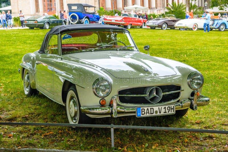 BADEN BADEN, GERMANY - JULY 2019: white beige MERCEDES-BENZ 190 SL roadster cabrio 1955 1963, oldtimer meeting in Kurpark stock photography