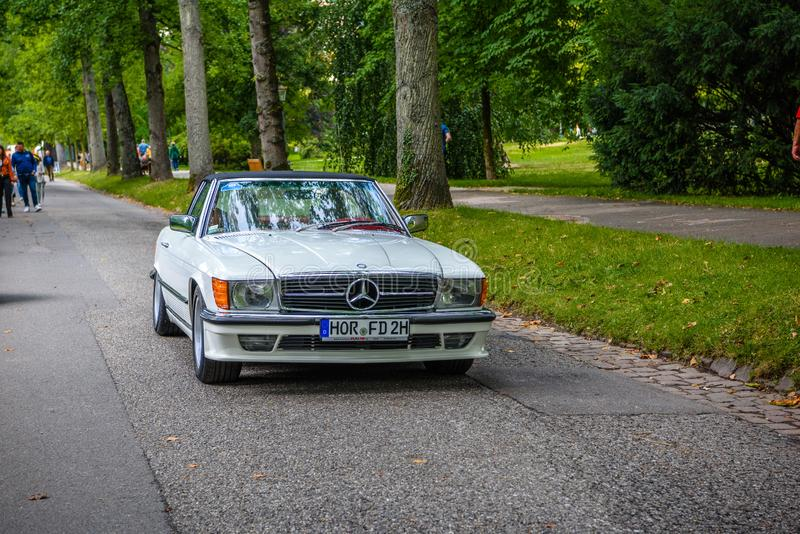 BADEN BADEN, GERMANY - JULY 2019: white ivory beige MERCEDES-BENZ SL R107 cabrio 1971 1989, oldtimer meeting in Kurpark stock photo