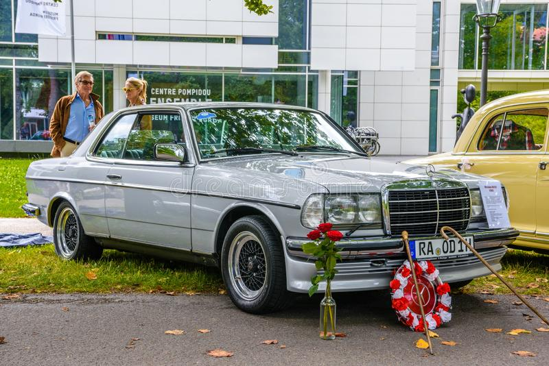 BADEN BADEN, GERMANY - JULY 2019: white ivory MERCEDES-BENZ W123 230CE coupe 1976 1986, oldtimer meeting in Kurpark stock images