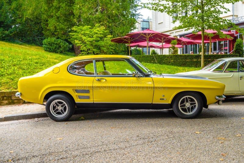 BADEN BADEN, GERMANY - JULY 2019: yellow black FORD CAPRI MK I 2800 1969 1974 sport coupe, oldtimer meeting in Kurpark stock images
