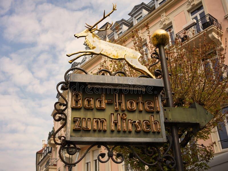 BADEN-BADEN, BADEN-WÃœRTTEMBERG, GERMANY - APRIL 12, 2019: Nostalgic neon sign with shiny golden deer. royalty free stock image