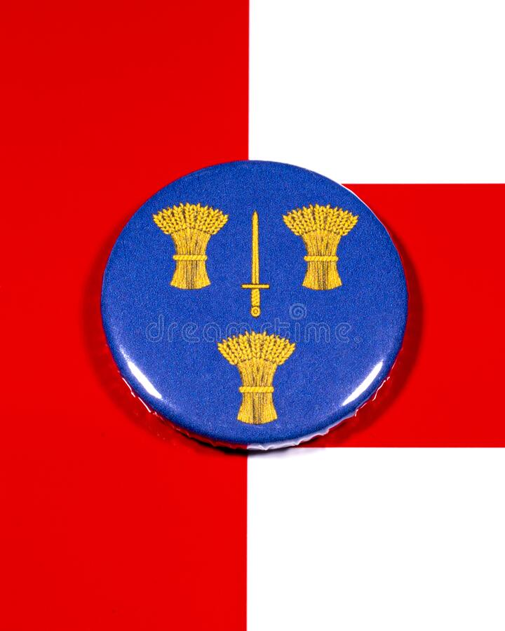 Cheshire in England. A badge portraying the flag of the English county of Cheshire pictured over the England flag stock image