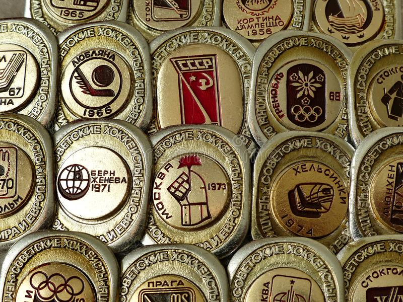 Badges with the inscription `Soviet hockey players world champions, Europe, Olympic Games. Emblem of the championship stock images