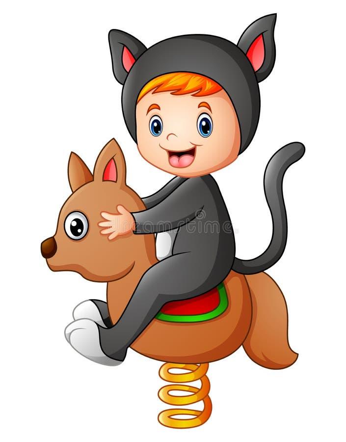 Badinez dans un costume de chat jouant le cheval de basculage illustration stock