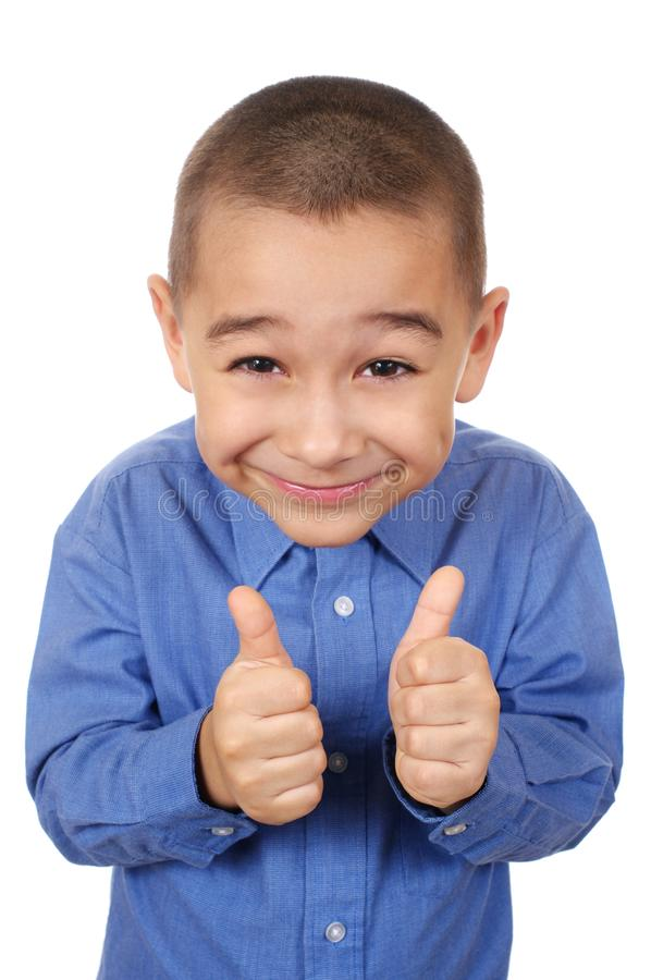 Badinez le sourire en renonçant à des pouces images stock