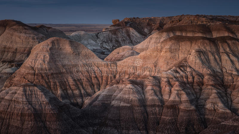 Badland Formations in Blue Mesa Area Under Full Moon Light in Petrified Forest National Park, Arizona stock photos
