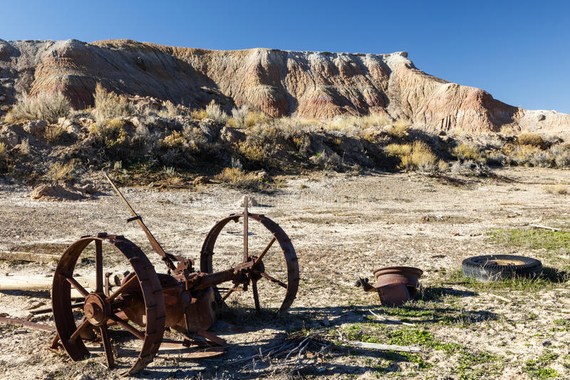 Badlands desert hills landscape rusty wheels royalty free stock photos