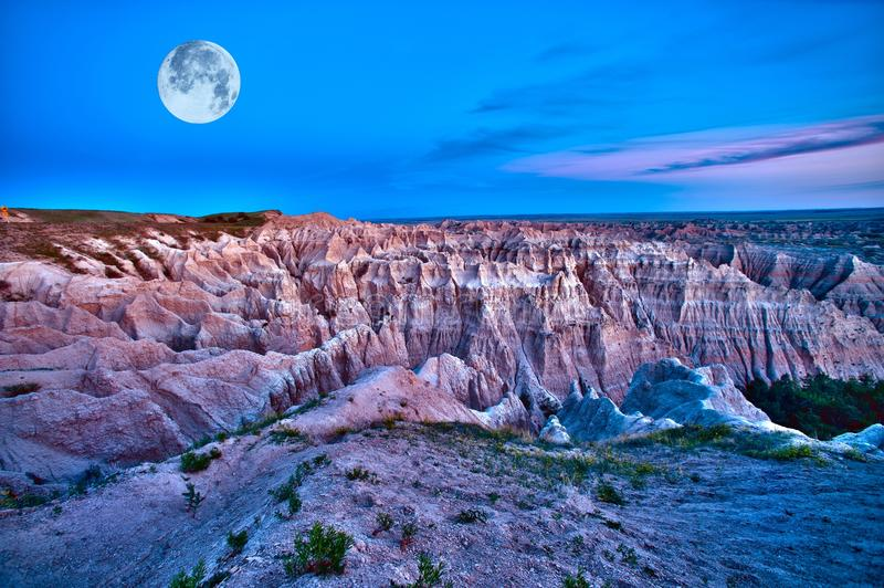 Badlands Dusk. (HDR) with Full Moon on the Sky. Beautiful Scenic Photography. Badlands National Park, U.S.A royalty free stock photos
