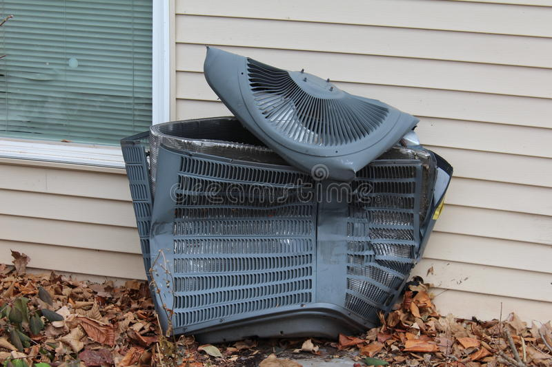 Badly damaged central AC unit stock photo