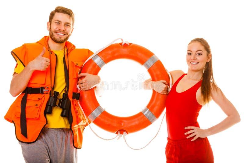 Badmeesters in reddingsvest met ringsboei Succes royalty-vrije stock afbeelding