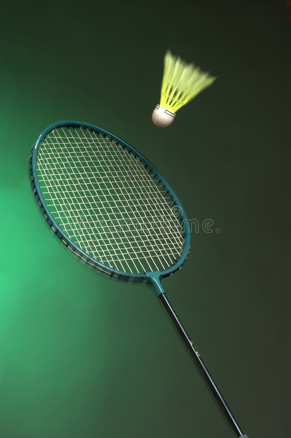 Badminton. Racket and shuttle on green background close up stock images