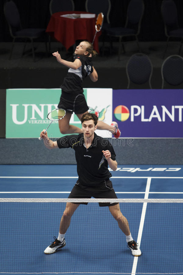 Badminton players Jacco Arends and Selena Piek. ALMERE, THE NETHERLANDS - FEBRUARY 1: Jacco Arends (front) and Selena Piek (back) reach the semi finals in the royalty free stock image