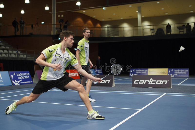 Badminton players Koen Ridder and Ruud Bosch. ALMERE, THE NETHERLANDS - FEBRUARY 2: Koen Ridder (left) and Ruud Bosch (right) reach the final in the National royalty free stock photography