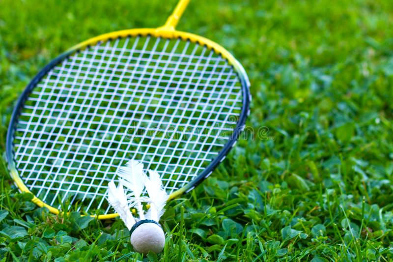 Badminton racket on grass royalty free stock images