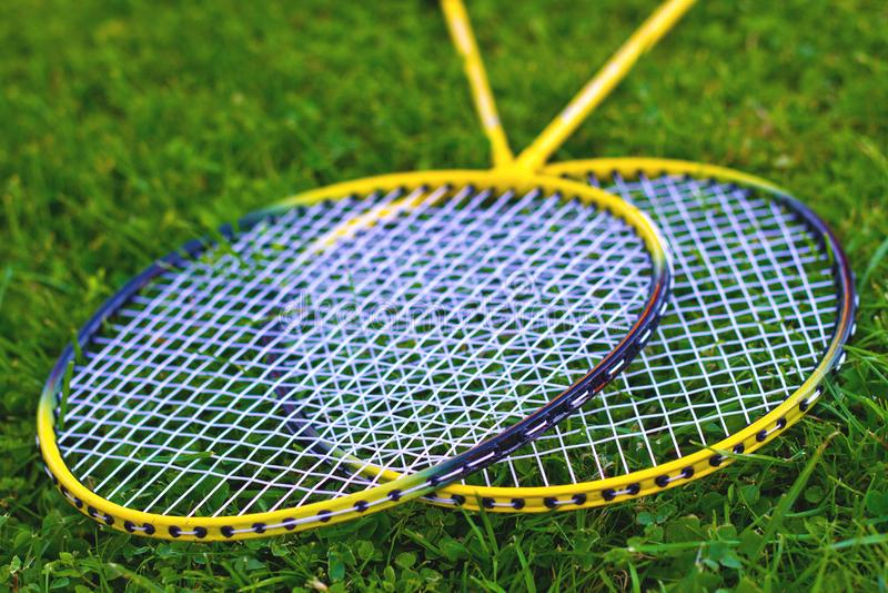 Badminton racket on grass stock image