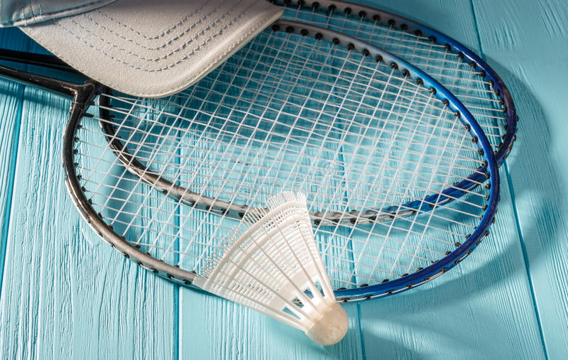 Badminton racket and shuttlecock. On a turquoise background stock photo