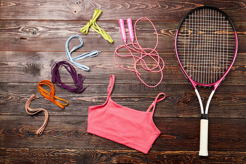 Badminton racket and skipping rope. Disclose your motivation stock photos