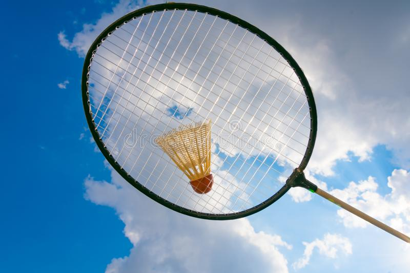 Badminton racket with a view of the sky. In the summer stock photography