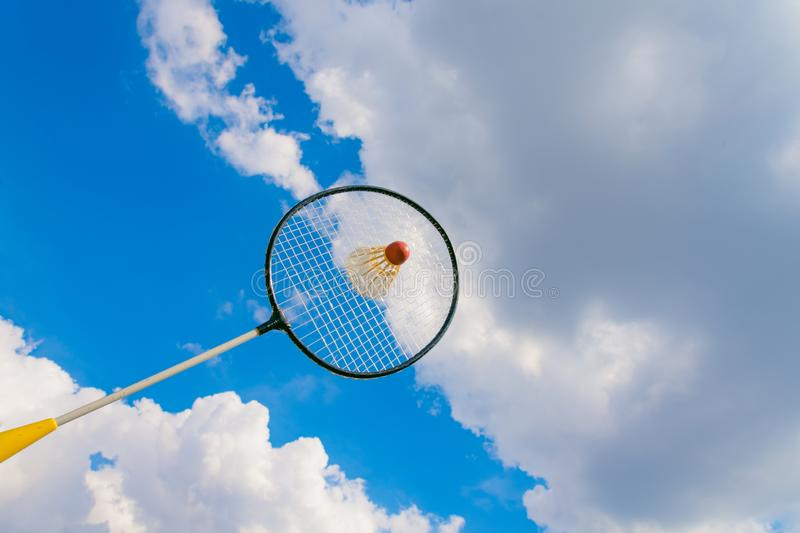 Badminton racket with a view of the sky. In the summer royalty free stock images