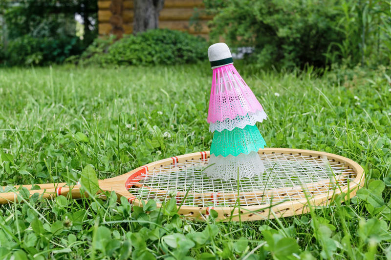 Badminton rackets and shuttlecocks on grass royalty free stock images