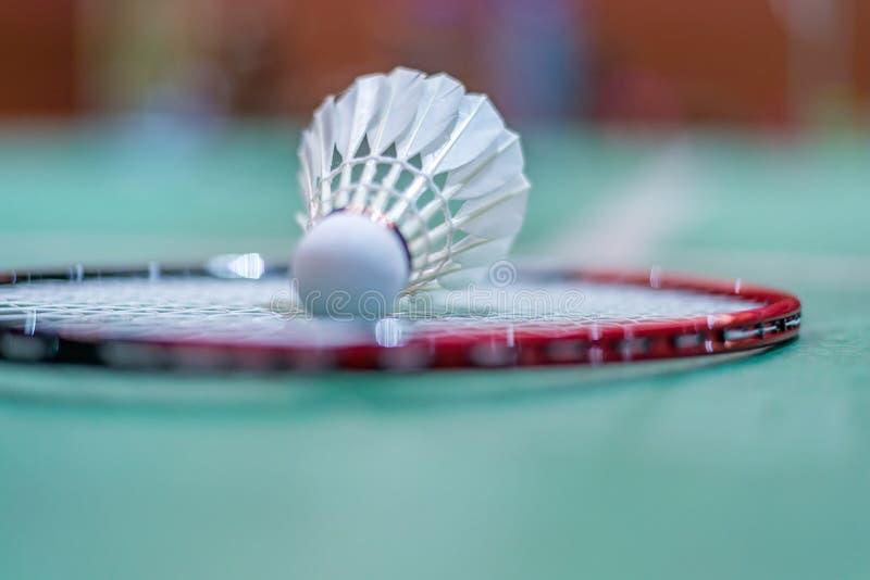 Badminton shuttlecock on badminton racket on floor.  royalty free stock photography